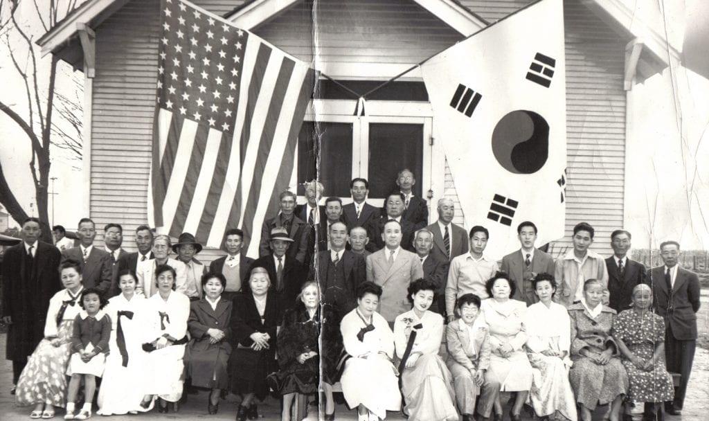 Korean men, women, and children in front of a church