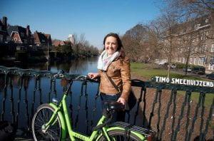 Raizel on canal bridge in Amsterdam