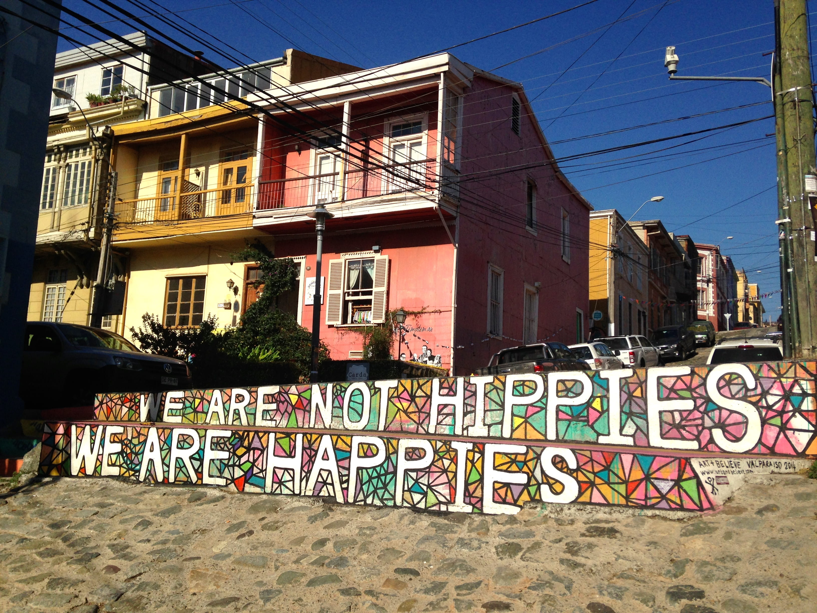 "Wall with painted ""We are not hippies. We are happies."""