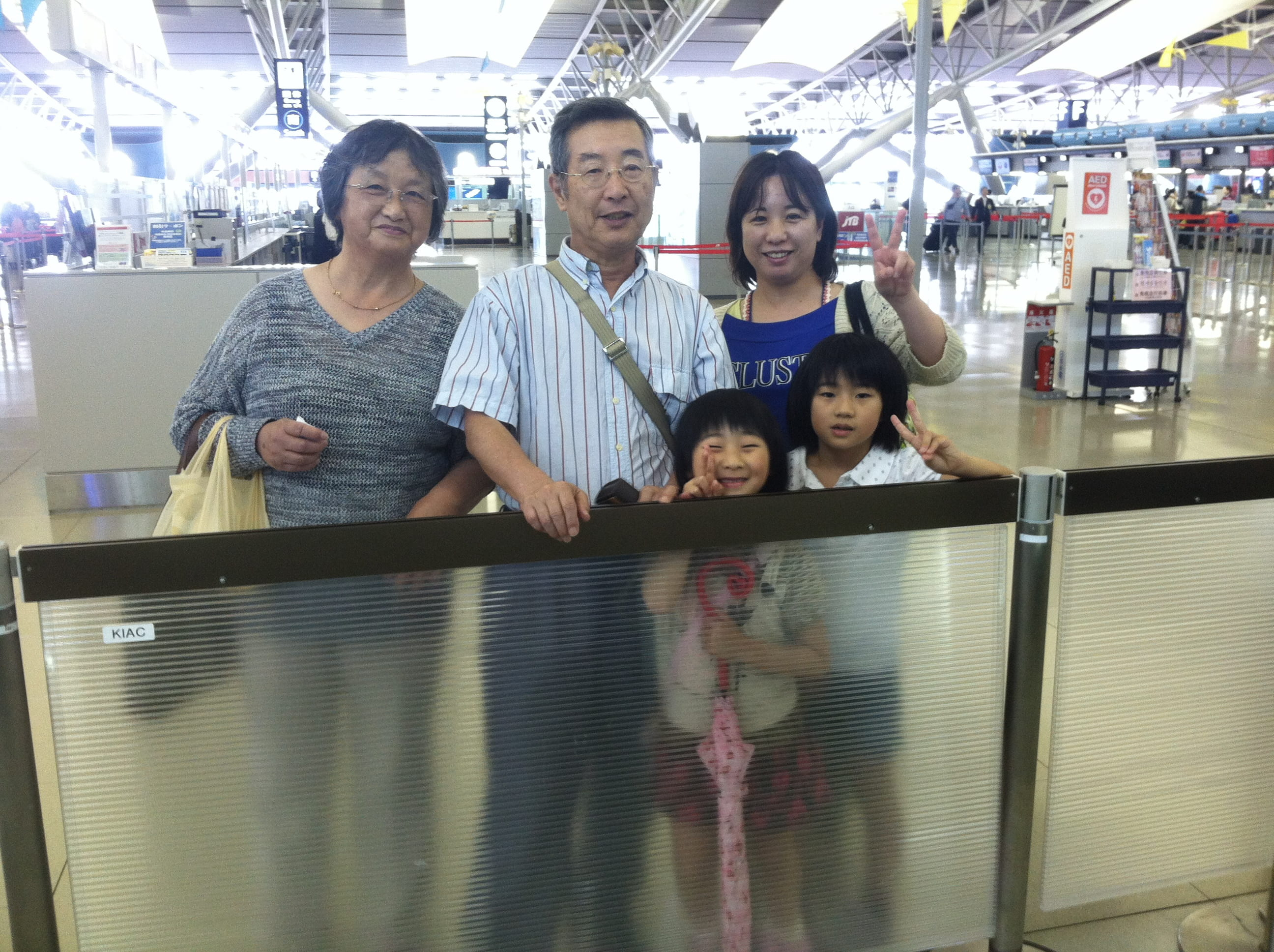 Host family saying goodbye at airport