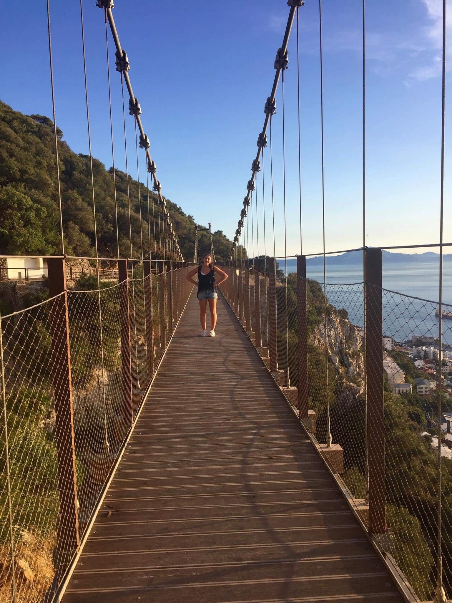 Author standing on a suspension bridge