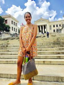 Bella standing on steps of University of Havana