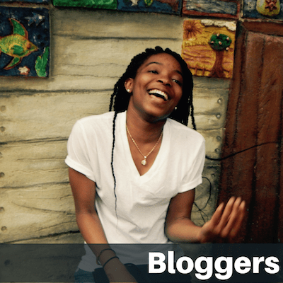 "Text on image ""Bloggers"": Cheerful female student talking animatedly"