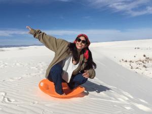 Esperanza sitting on sand dune