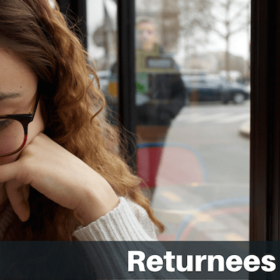"""Text on image """"Returnees"""": Side of female student's face sitting in cafe window"""