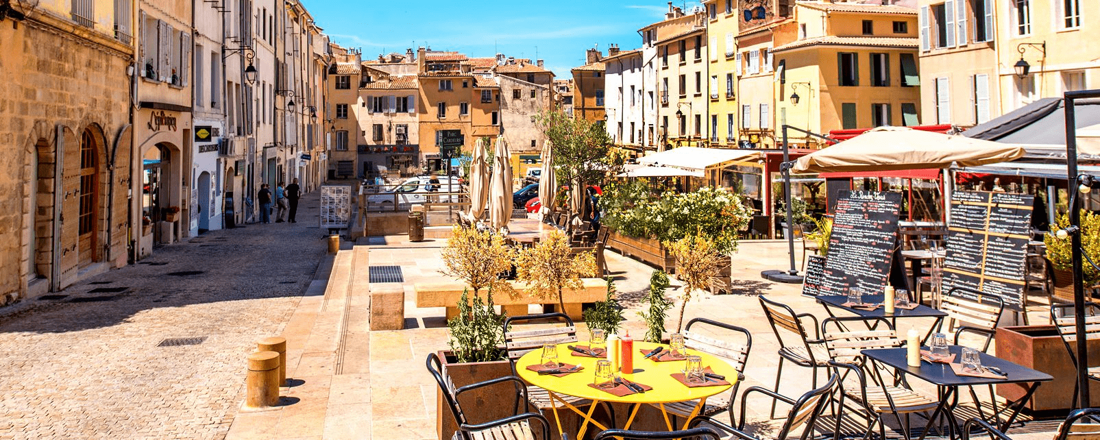 View of street with cafe and outdoor seating in Aix-en-Provence, France