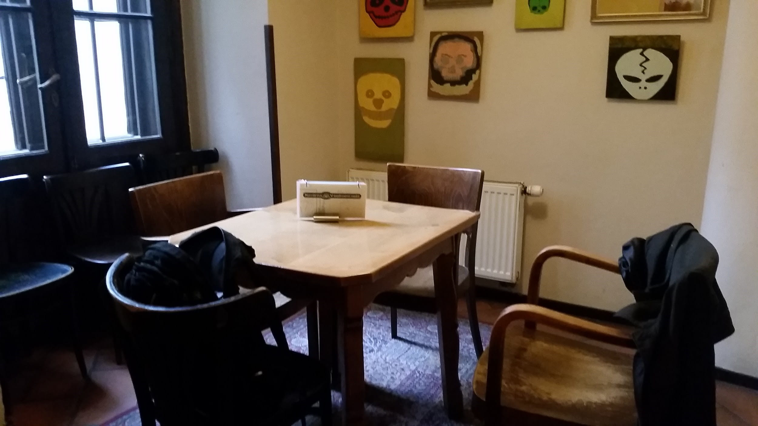 Back room in a small cafe with table and chairs