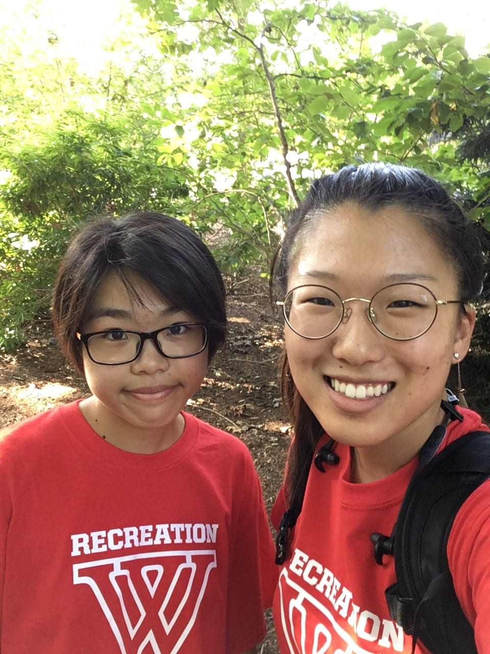 Emily with her friend and exchange student from Smith, both wearing red shirts with a large W