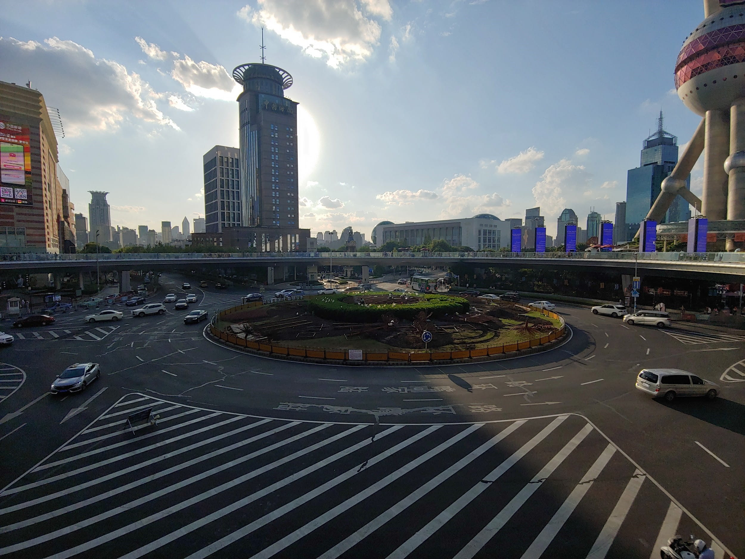 Roundabout in Shanghai with skyline and blue sky in the background