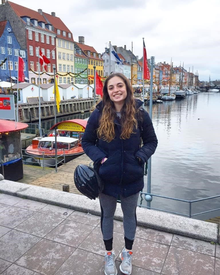 Talia standing in front of colorful houses in Copenhagen