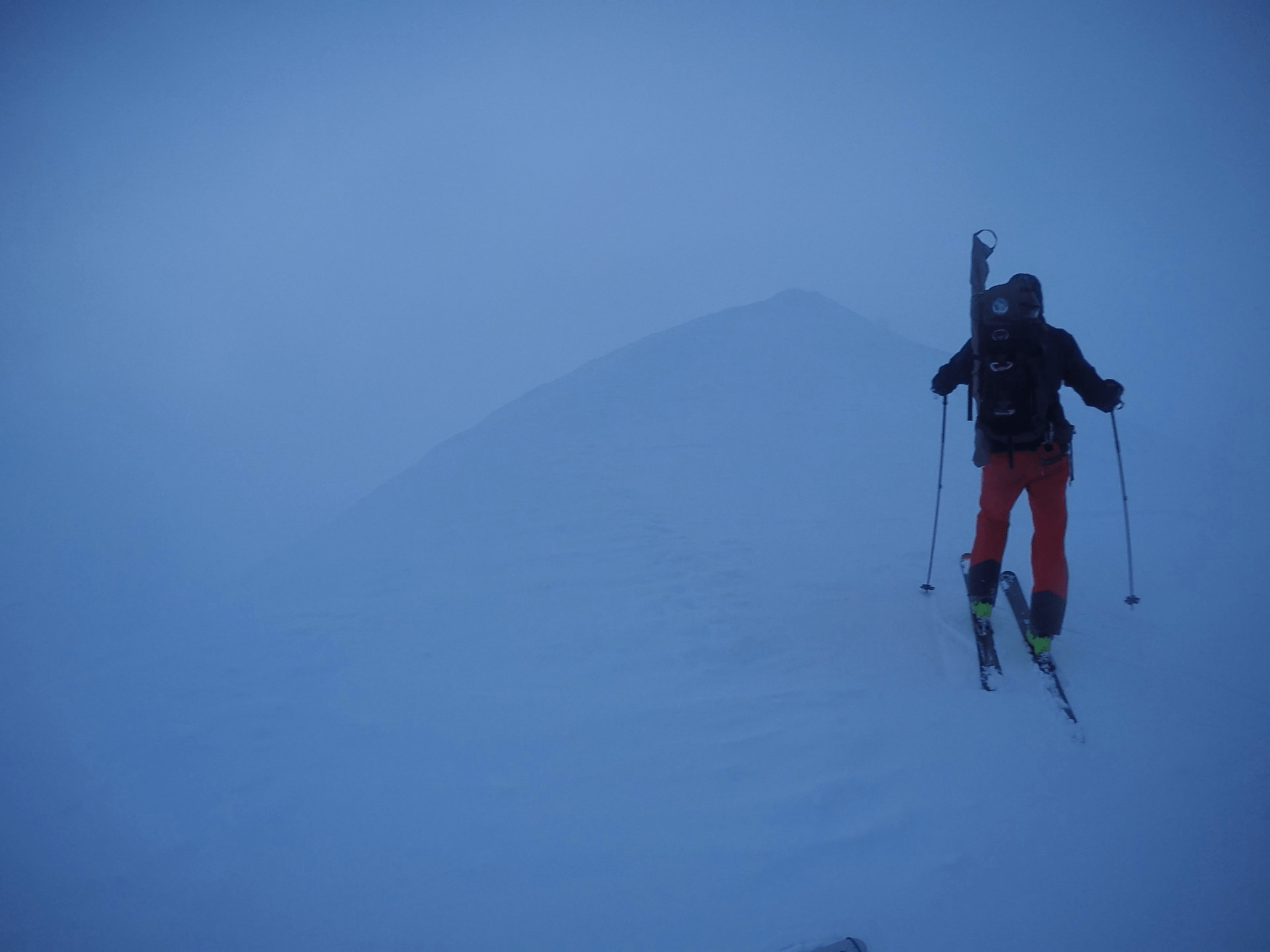 Person skiing in low-lighting