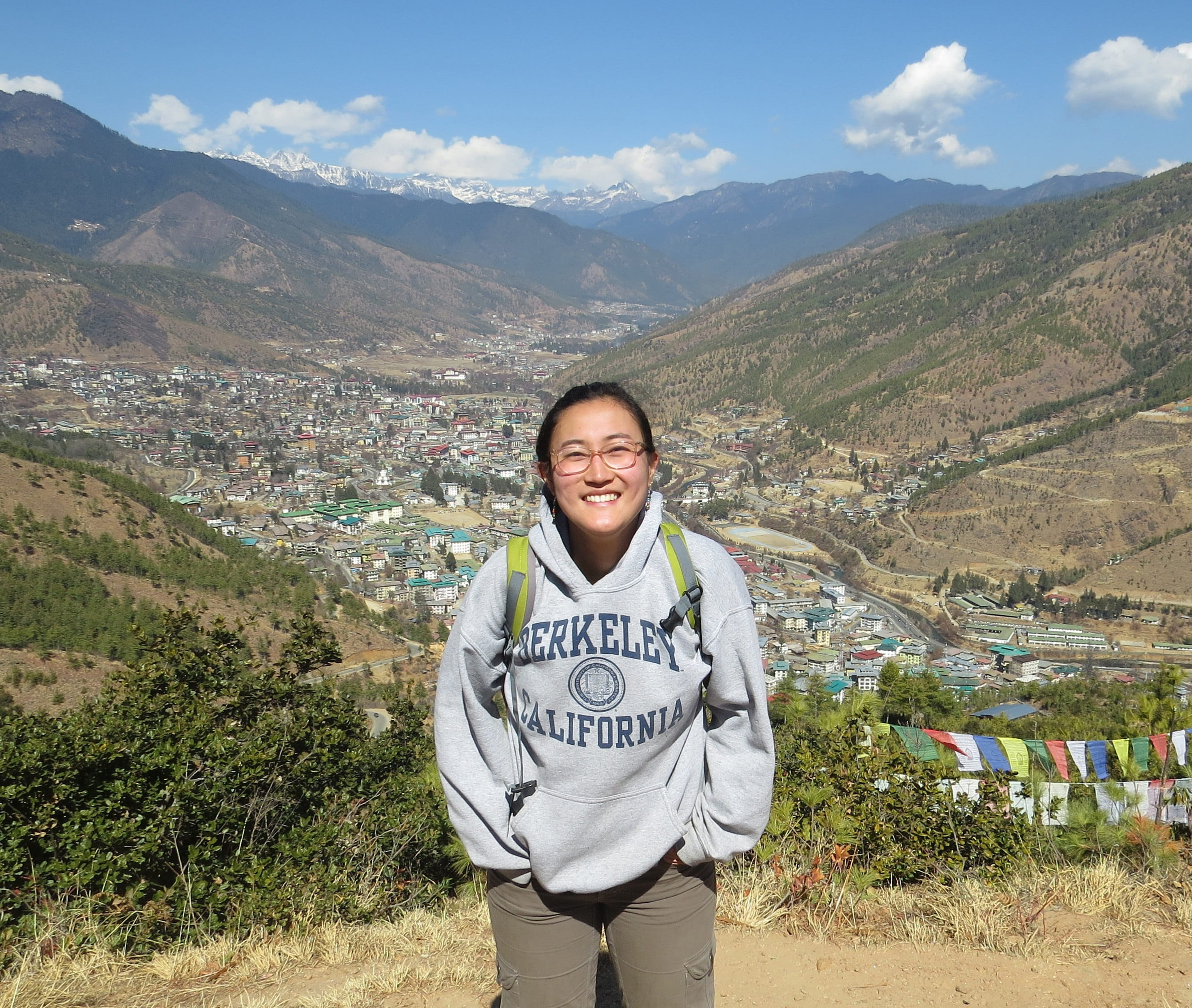 Yuko standing with mountains and blue sky in background