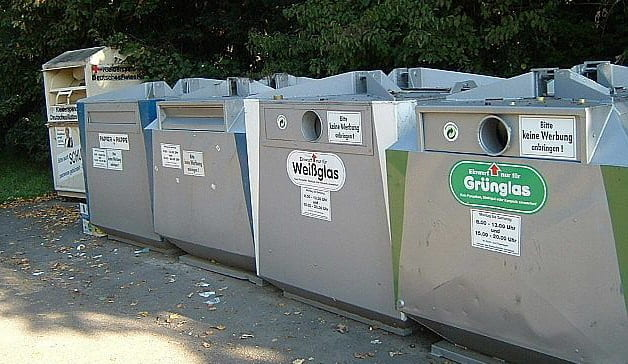 Five grey bins that are used for trash and recycling separation in Germany