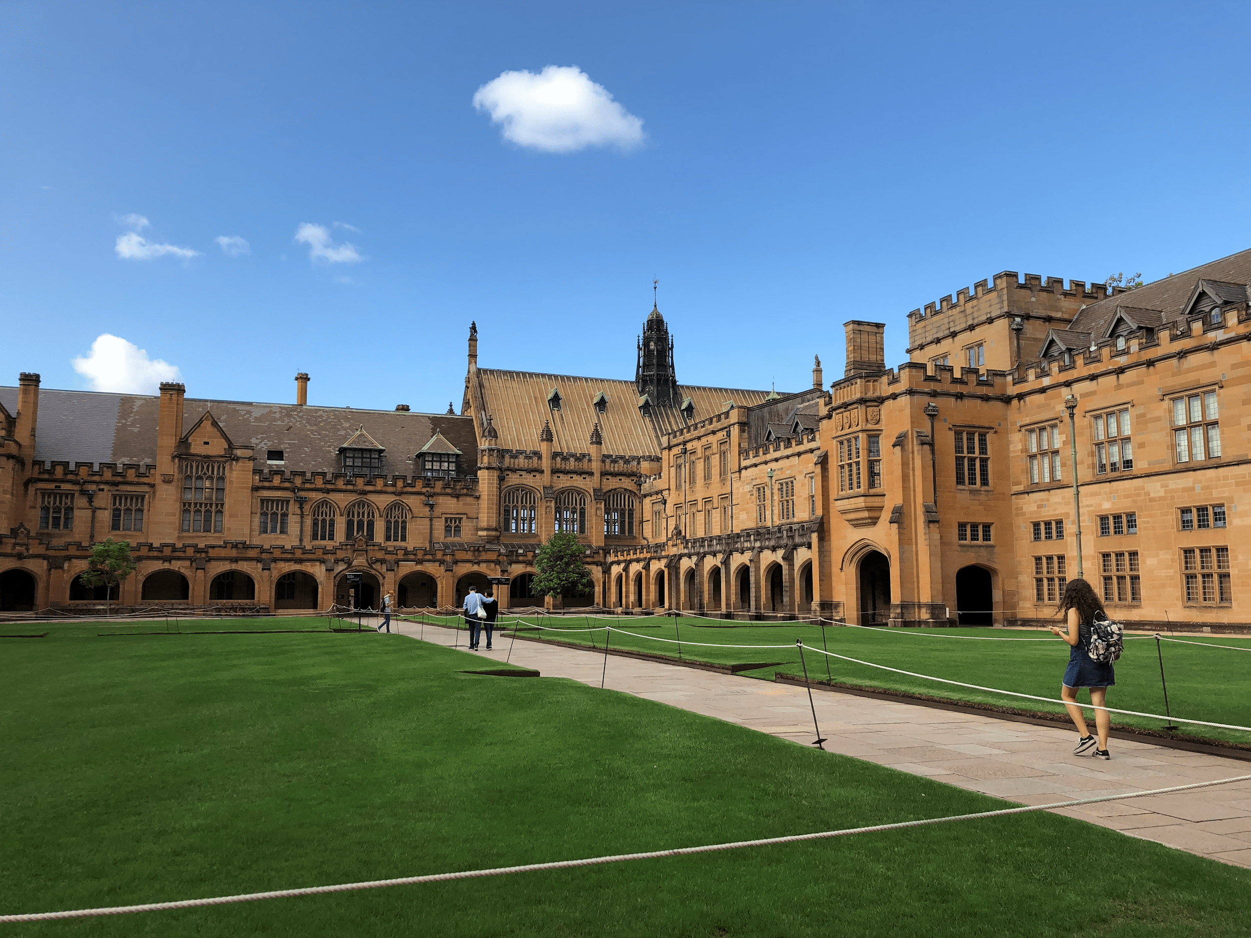 large old building with green grass on university of Sydney campus
