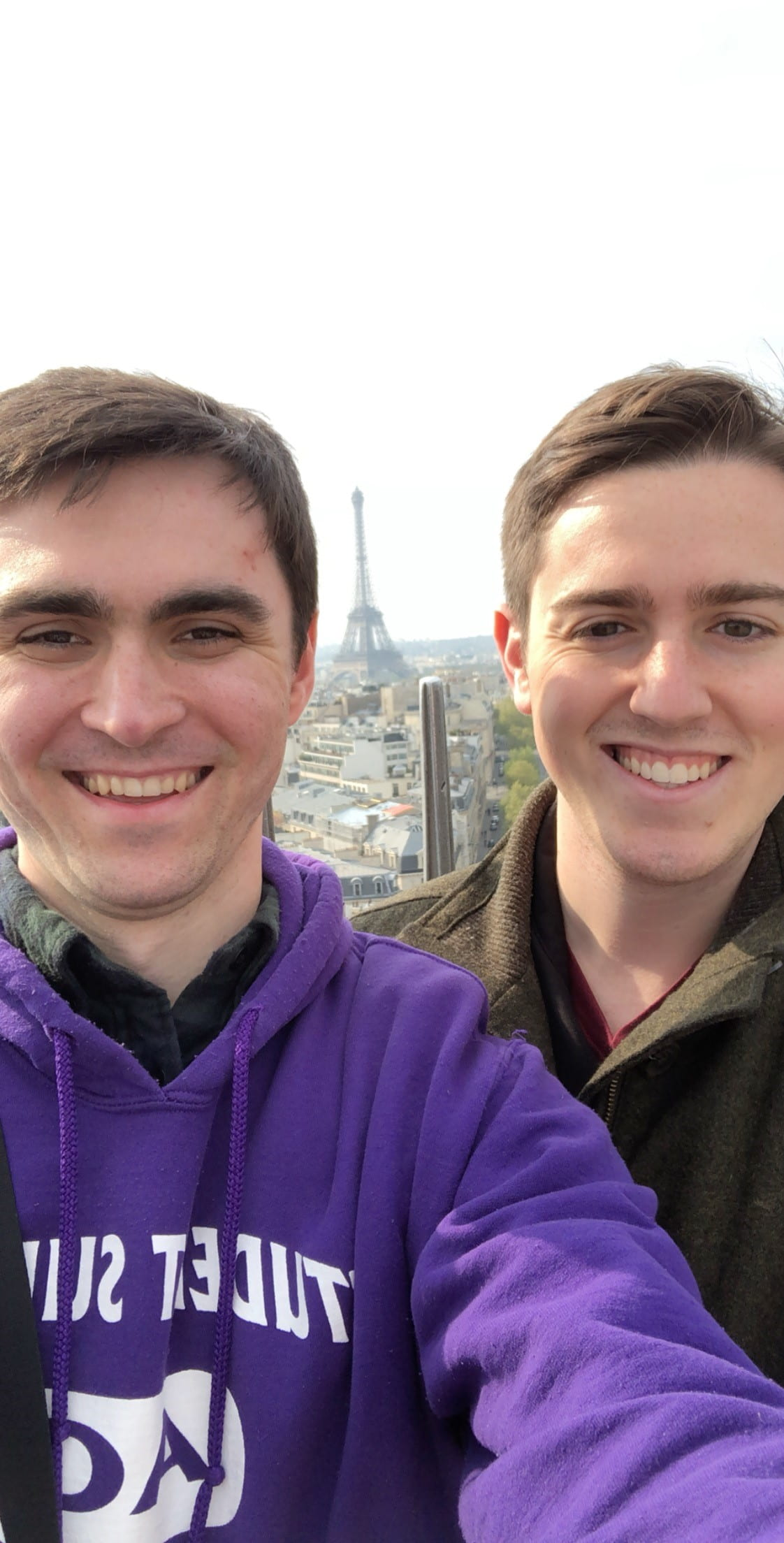 Selfie of Stuart and his partner with Eiffel Tower in the distance
