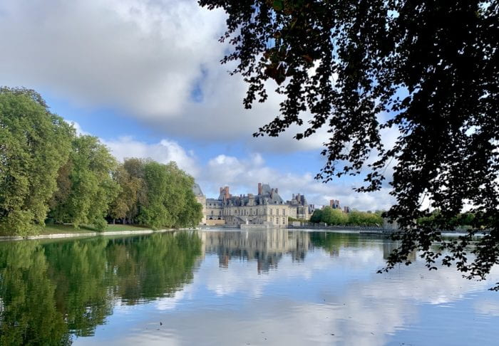 View of Chateau Fontainebleau from a lake