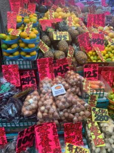Onions and assorted vegetables on produce stand