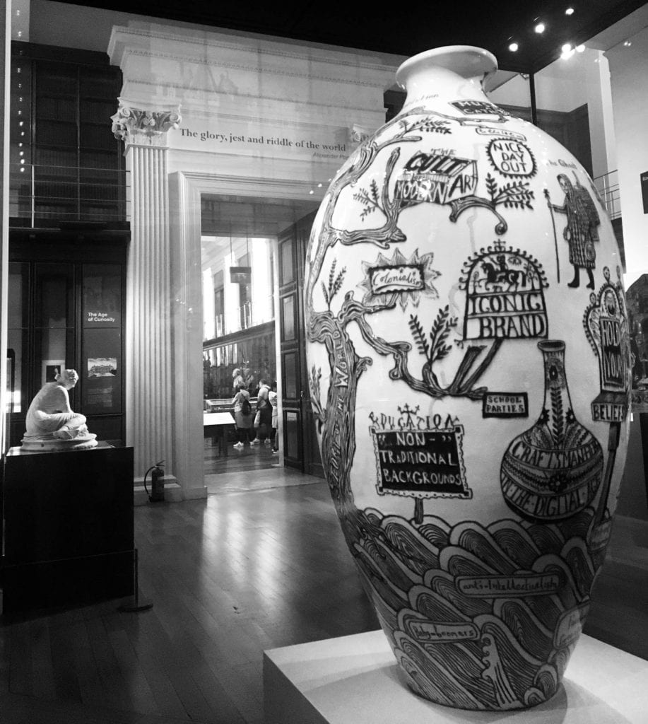 A large vase with various designs on display