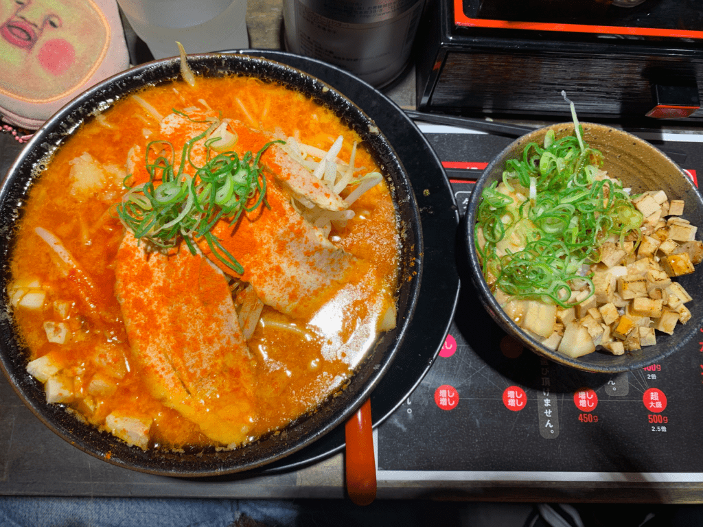 A huge bowl of ramen with a char siu pork bowl.