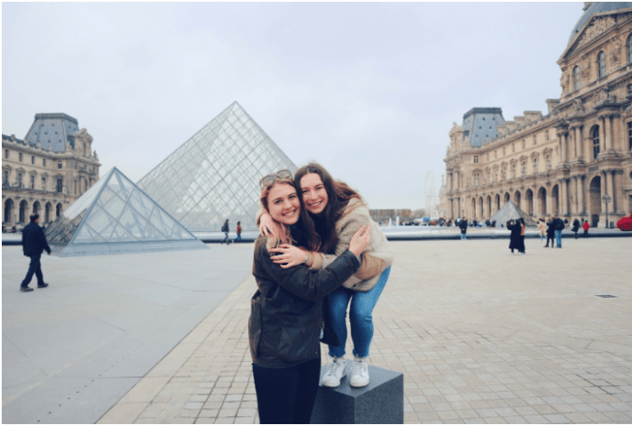 two girls in front of the Louvre Pyramid