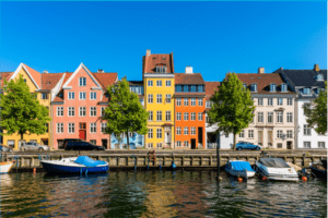 Brightly colored buildings along a canal