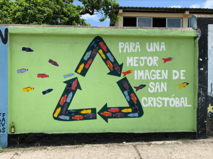 "This mural encourages people to recycle plastic bottles ""for a better image of San Cristóbal."" Ironically, there is a discarded beer bottle in the lower left hand corner."