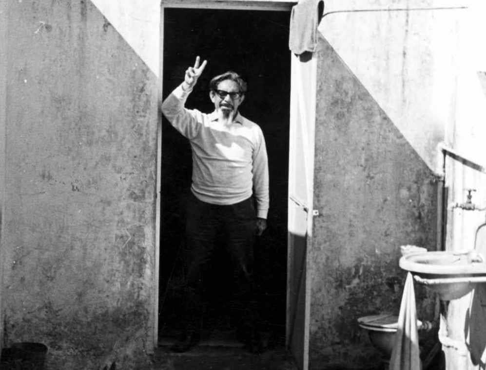 JOSÉ REVUELTAS, POSING IN A CELL AT LECUMBERRI PRISON