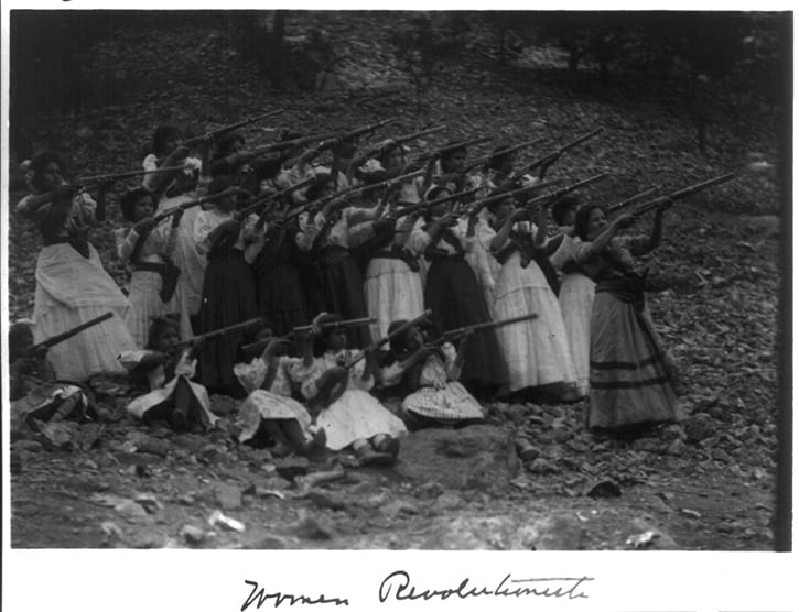 female soldiers holding rifles