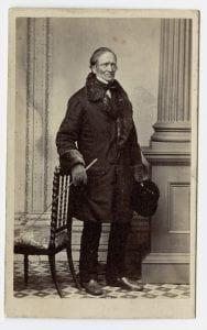 Full-length portrait of Edward Hitchcock in fur coat