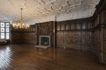 The richly adorned mantelpiece was likely executed in commemoration of Sir Roger Bodenham's new title. Bodenham was knighted at the 1603 coronation ceremony where King James VI of Scotland became James I of England and Ireland.