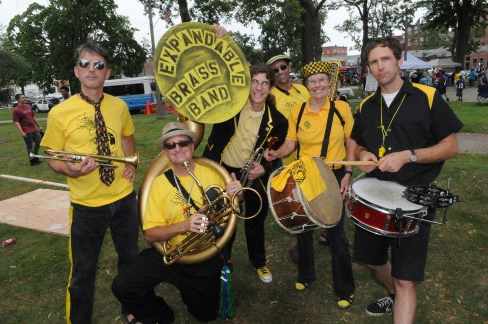 Expandable Brass Band members pose before a gig