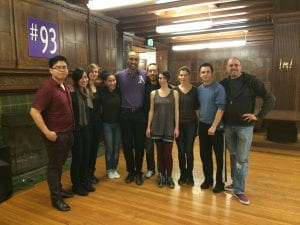 Club photo of Amherst Argentine Tango club. 10 people stand in a line facing the camera.