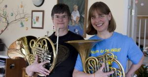 Portrait photo of two French horn players