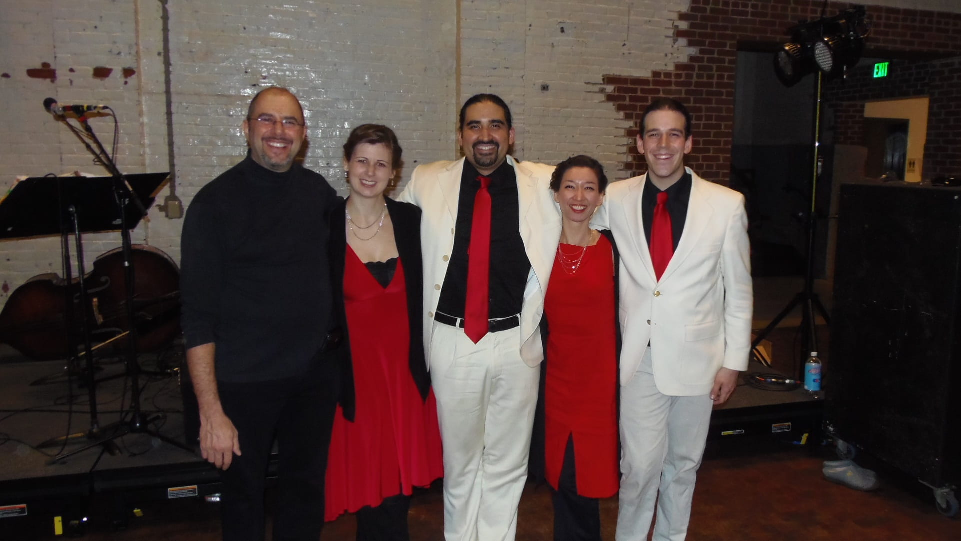 Daniel Trenner standing side by side with four tango musicians.