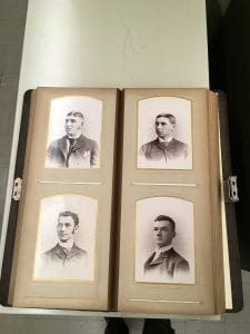 Class Album 1889, open to show four portraits