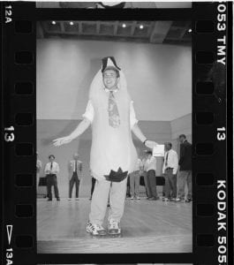 man in a banana suit at a rehearsal poses