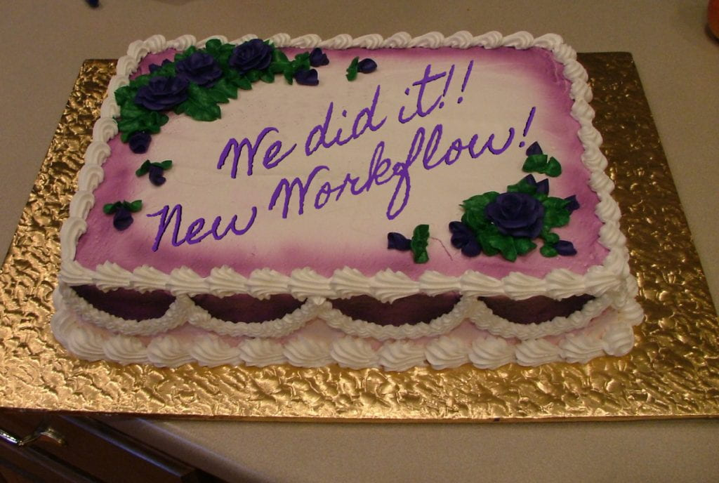 picture of a sheet cake that says 'We did it!! New Workflow!""
