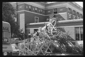 Photographs of books being moved from Converse Hall to Robert Frost Library, 1965 July 14