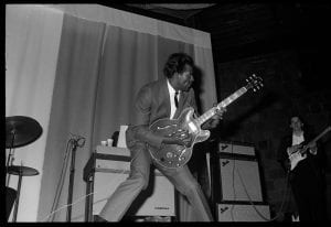 A photograph of Chuck Berry playing the guitar at prom