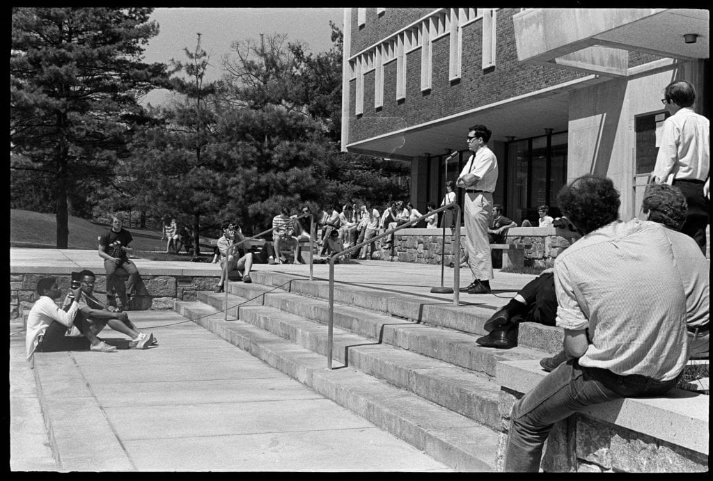 speaker on steps of frost library