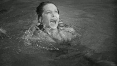 woman in pool screaming