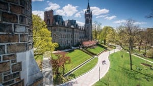Photo of the University lawn in front of the University Center building taken from Linderman Library
