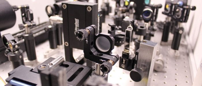 Close-up of sample holder and optics inside our Helios-EOS.