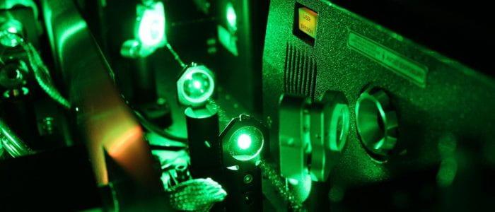 Inside the Libra: green laser light from the Evolution laser passing through lenses.