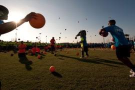 Students throwing dodgeballs
