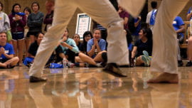 Students watch capoeira demonstration