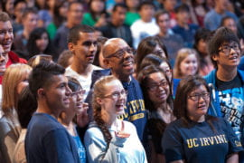 Michael Drake poses with new students