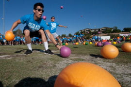 Student grabs a dodgeball during the game
