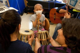 Catherine Ordaz tries out the conga drums