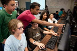 Naren Sathiya helping middle school students